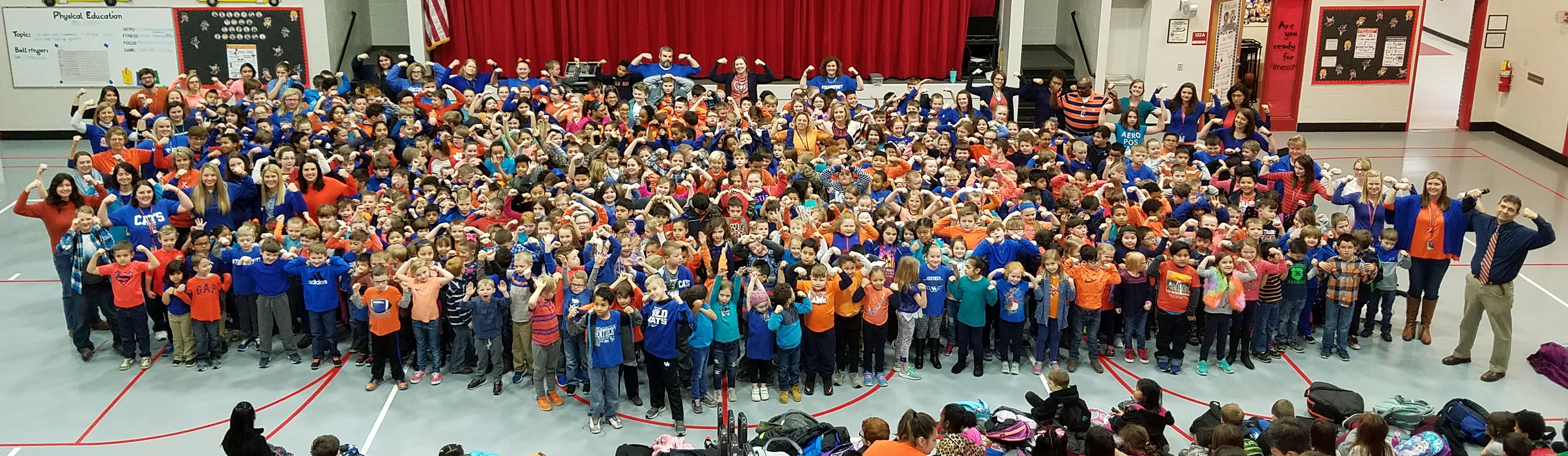 Students and staff wearing orange and blue to support Marshall County Schools.