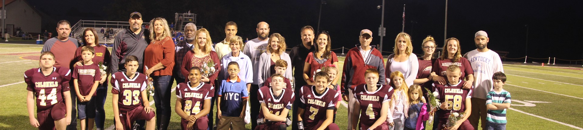 Bourbon County Middle School's 8th grade football players with family on the field.