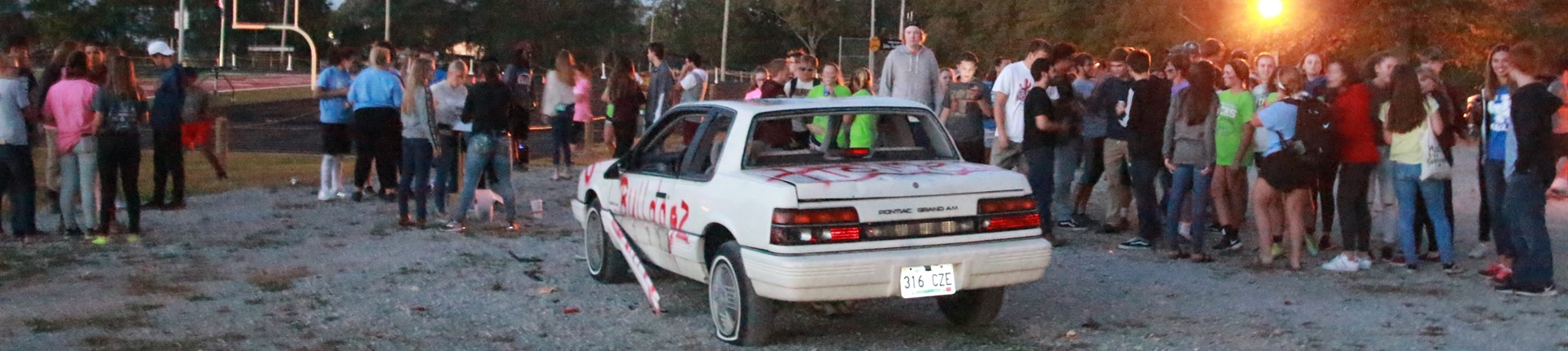 Students prepare to smash a vehicle in preparation for Homecoming.